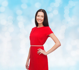 smiling woman in red dress