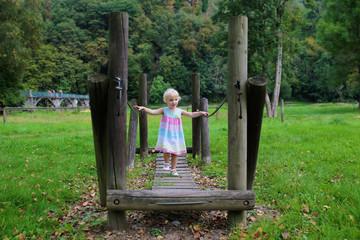 Little child having fun at playground