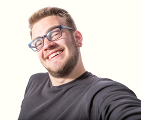 Happy young man taking a selfie photo, Isolated