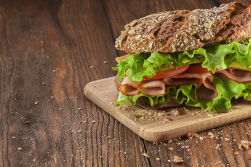 Sandwich on the wooden table