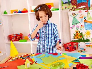 Child with  scissor at school.