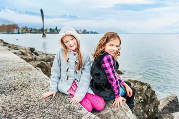 Cute little girls having fun outdoors