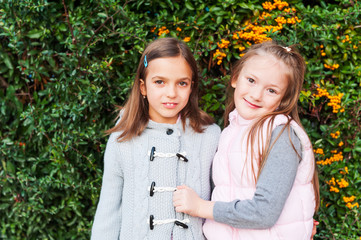 Outdoor portrait of adorable little girls