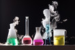Leinwanddruck Bild - Glass in a chemical laboratory filled with colored liquid during