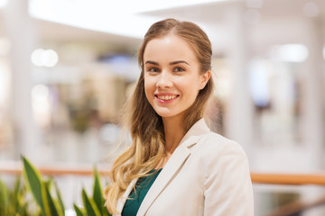 happy young woman in mall or business center