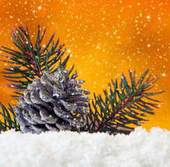 Golden christmas background and fir cones.