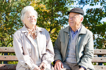 Beautiful senior couple sitting in the park