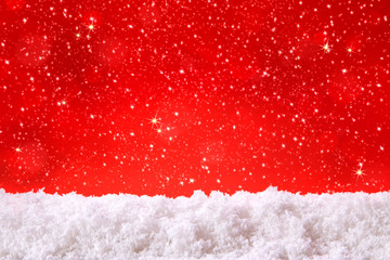 Red christmas background and white snow.