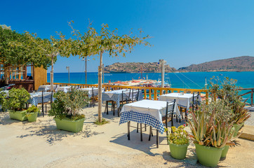 Traditional Greek taverna with view at Spinalonga island