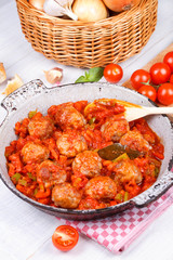 Meatballs with tomato sauce in a pan