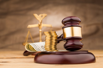 judge gavel with money  and scales closeup