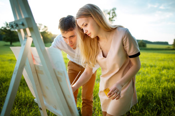 Young couple painting