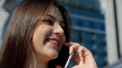 happy beautiful girl talking on a smartphone