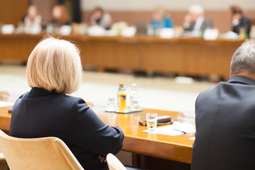 blond hair woman at conference table