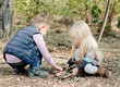Cute Toddlers Playing with Dry Sticks on Ground