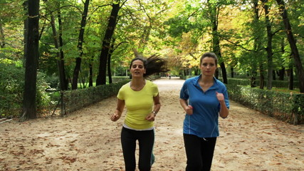 Woman jogging in the park, steadycam shot