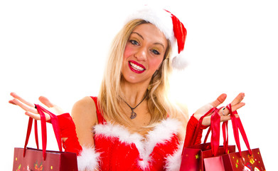 cheerful christmas woman in santa's wear smiling and holding sho