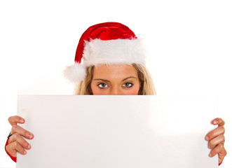 Christmas pretty woman peeking from  blank sign billboard isolat