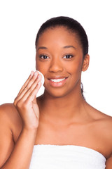 Young beautiful african woman removing makeup - Skin cleaning -
