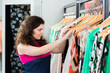Young woman shopping in fashion department store