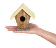 Hand is holding wooden house for birds