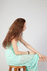 Woman with long hair looking thoughtful