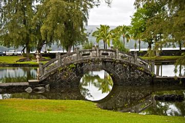 Stone bridge in the Japanese Garden. Hilo, Hawaii