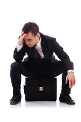 Sad businessman isolated on the white