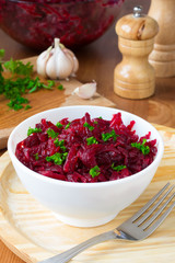 Traditional Russian salad with grated beetroot and garlic