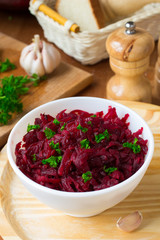 Traditional Russian salad with grated beetroot