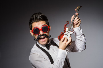 Funny man with mini guitar