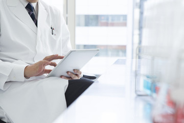 Men are using the tablet in the laboratory