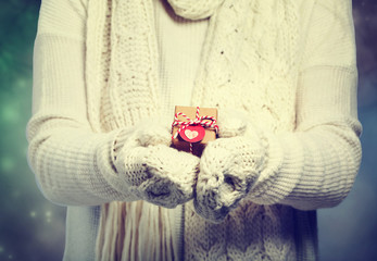 Small gift box in womans hands