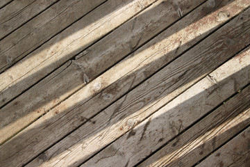 Sun shines through on wooden boards background