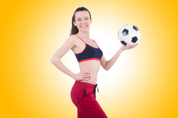 Young woman with football on white