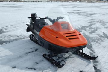 Orange snowmobile on ice