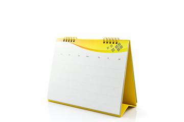 Yellow blank paper desk spiral calendar.