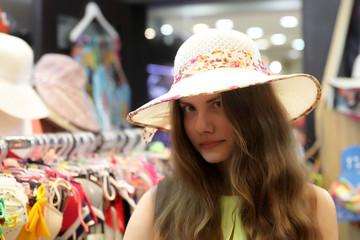 Teen at shop hats