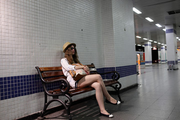 Teen on the bench at subway platform