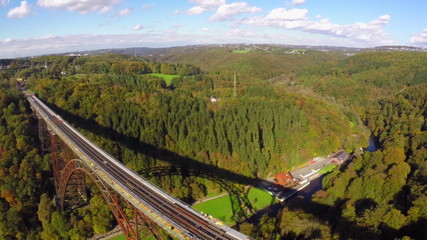 Panorama of high steel bridge over river valley railroad train