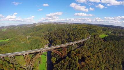 Old high steel bridge in Europe Germany, railroad train, aerial