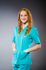 Young woman doctor in medical concept