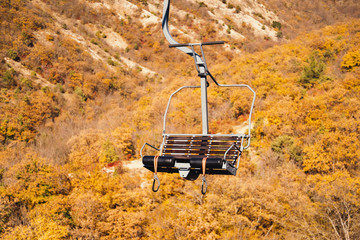 Cableway in autumn mountains