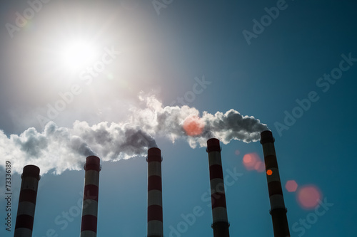canvas print picture a row of power plant chimney
