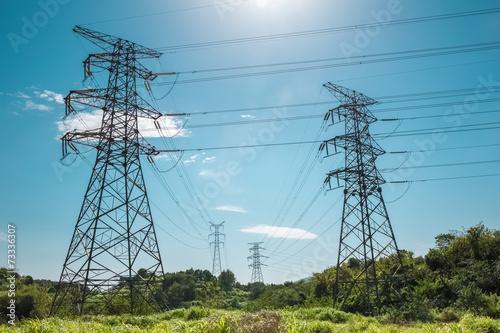 Zdjęcia na płótnie, fototapety, obrazy : electricity pylon against a blue sky