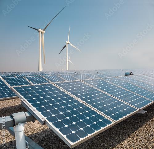Leinwanddruck Bild solar panels and wind power farm