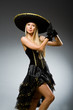 Woman wearing black sombrero dancing