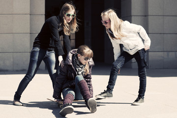 Group of teenage girls with skateboard