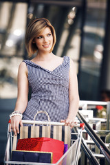 Beautifull woman with shopping cart