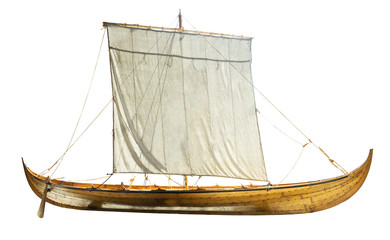 Wooden boat with sails unfurled